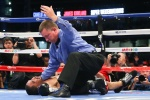 """HOUSTON, TX - MAY 9: Saul """"Canelo"""" Alvarez (not shown) knocks out James Kirkland (black/red trunks) in the 3rd round of their 12 round super welterweight fight at Minute Maid Park on May  9, 2015 in Houston, Texas. (Photo by Ed Mulholland/Golden Boy/Golden Boy via Getty Images) *** Local Caption ***Saul Alvarez; James Kirkland"""