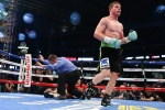 """HOUSTON, TX - MAY 9: Saul """"Canelo"""" Alvarez (black/green trunks) knocks out James Kirkland (black/red trunks) in the 3rd round of their 12 round super welterweight fight at Minute Maid Park on May  9, 2015 in Houston, Texas. (Photo by Ed Mulholland/Golden Boy/Golden Boy via Getty Images) *** Local Caption ***Saul Alvarez; James Kirkland"""