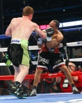 """HOUSTON, TX - MAY 9: Saul """"Canelo"""" Alvarez (black/green trunks) and James Kirkland (black/red trunks) during their 12 round super welterweight fight at Minute Maid Park on May  9, 2015 in Houston, Texas. (Photo by Ed Mulholland/Golden Boy/Golden Boy via Getty Images) *** Local Caption ***Saul Alvarez; James Kirkland"""