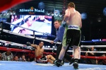 """HOUSTON, TX - MAY 9: Saul """"Canelo"""" Alvarez (black/green trunks) knocks down James Kirkland (black/red trunks) during their 12 round super welterweight fight at Minute Maid Park on May  9, 2015 in Houston, Texas. (Photo by Ed Mulholland/Golden Boy/Golden Boy via Getty Images) *** Local Caption ***Saul Alvarez; James Kirkland"""
