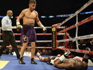 David Lemieux, centre, stands over Hassan N'Dam after knocking him down as they battle for the vacant International Boxing Federation middleweight championship Saturday, June 20, 2015 in Montreal. THE CANADIAN PRESS/Ryan Remiorz